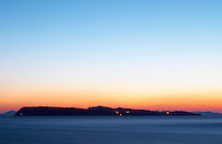Sunset over the sea. View over the islands Daksa and others. House lights. Dark blue sea. Uvala Sumartin bay between Babin Kuk and Lapad peninsulas. Dubrovnik, new city. Dalmatian Coast, Croatia, Europe.