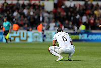 SWANSEA, WALES - MAY 17: Ashley Williams of Swansea looks dejected after the Premier League match between Swansea City and Manchester City at The Liberty Stadium on May 17, 2015 in Swansea, Wales. (photo by Athena Pictures/Getty Images)