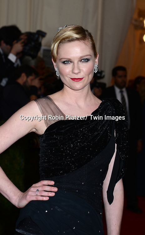 Kirsten Dunst attends the the Costume Institute Benefit on May 5, 2014 at the Metropolitan Museum of Art in New York City, NY, USA. The gala celebrated the opening of Charles James: Beyond Fashion and the new Anna Wintour Costume Center.