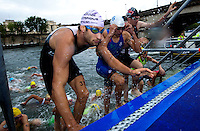 09 JUL 2011 - PARIS, FRA - Competitors run up the steps as they leave the water after the swim during the men's French Grand Prix series race. Pictured on left (number 37) is Daniel Hofer (Mulhouse Olympique Tri) (PHOTO (C) NIGEL FARROW)