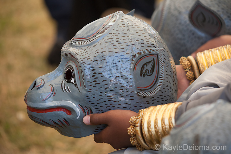 A boy's hands holding his Monkey Dance mask at the Cambodian New Year Celebration at El Dorado Park in Long Beach, CA