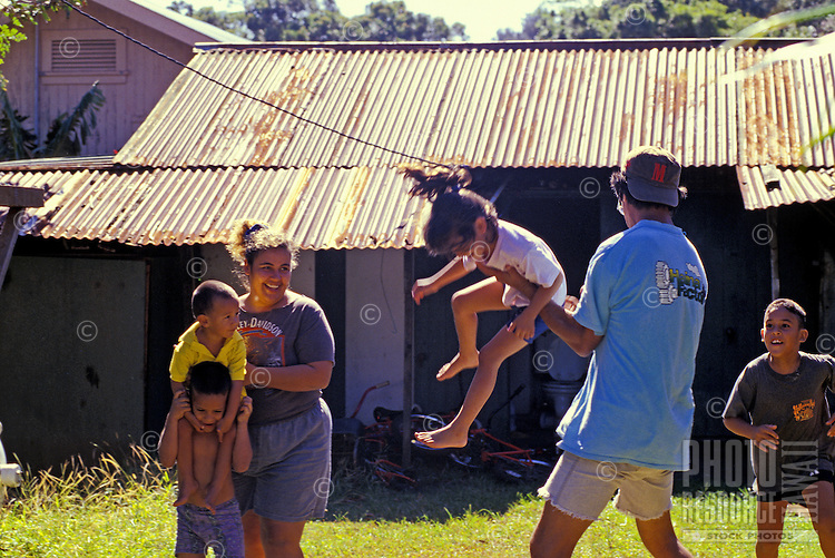 Parents playing with their children, Big Island, Hawaii