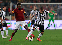 Mapou Yanga-Mbiwa   challanges  Arturo Vidal  during the Italian Serie A soccer match between   AS Roma and Juventus FC       at Olympic Stadium      in Rome ,March 02 , 2015