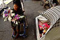 A women from Cochabamba City, Bolivia is bringing flowers for a symbolic funeral in La Paz Handicapped People camp, as two of her friends dies tonight, beaten by a car while tey were sleeping, in their own temporary camp, along the road. A group of handicapped people is tsill protesting in La Paz, Bolivia, to try to be eard by Evo Morales Government, to get a monthly 500 Bs vital bonus (some 60 USD). Government just wait for  them to be tired of protesting since they get to La Paz, one month ago, and don't show signals to look for negotiaitions.