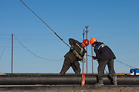 Yamal Peninsula, Russia, 08/07/2010..Gazprom workers drilling a new well-head in the Yamal Bovanenkovo gasfield project.
