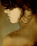 The profile of a young womans face with texture