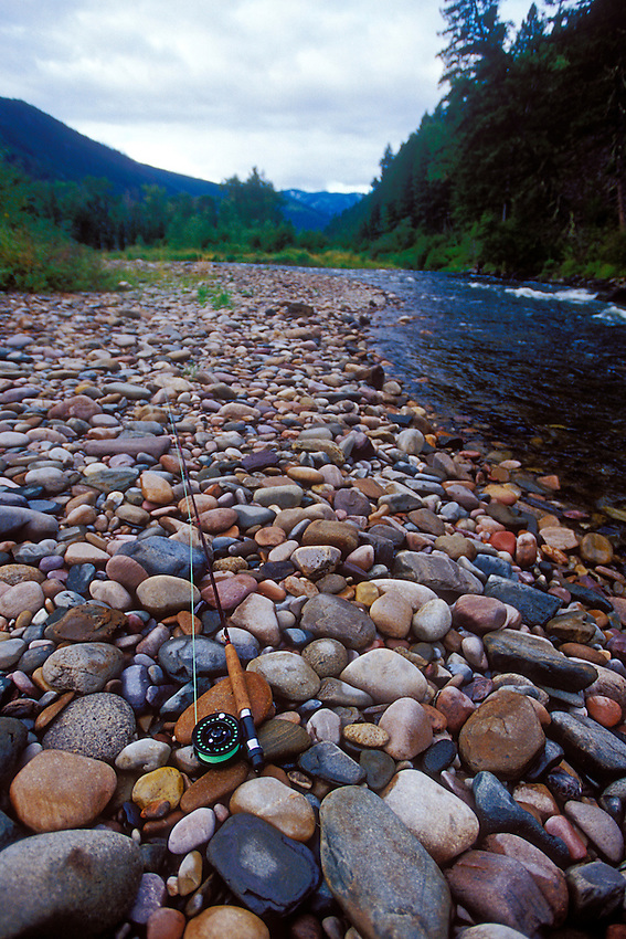 A fly rod rests on stones along the Rock Creek near Missoula Montana.