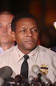 """Rockville, MD - October 24, 2002 -- Montgomery County Police Chief Charles Moose gets emotional as he reads the names of the victims of the """"Beltway Sniper"""" after announcing that the perpetrator was in custody.<br /> Credit: Ron Sachs / CNP<br /> (RESTRICTION: NO New York or New Jersey Newspapers or newspapers within a 75 mile radius of New York City)"""