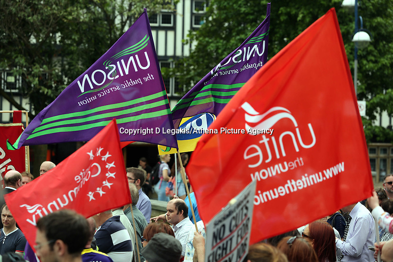 Swansea, UK. Thursday 10 July 2014<br /> Pictured: PCS, Unite and Unison flags flying at Castle Square Gardens, Swansea, south Wales.<br /> Re: Strikes are taking place across the UK in a series of disputes with the government over pay, pensions and cuts, with more than a million public sector workers expected to join the action.<br /> Firefighters, librarians and council staff are among those taking part from several trade unions, with rallies taking place across the UK.