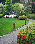 Washington Park Portland, OR<br /> Gravel path and lawn with flowering azaleas, The Japanese Garden