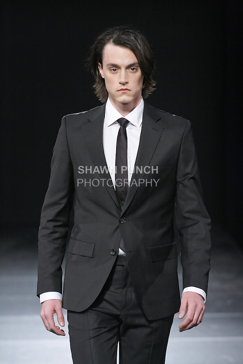 "Male models walk runway at the Nina Gleyzer Spring 2011 ""The Blossom"", during Couture Fashion Week Fall 2011 in New York."