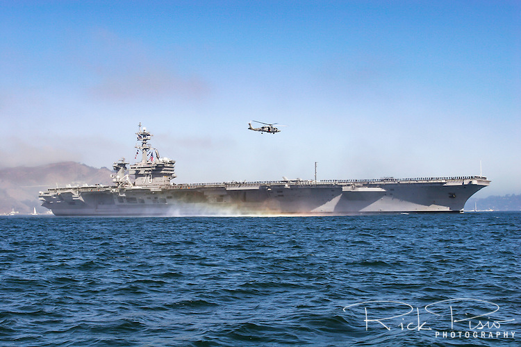 The USS Carl Vinson (CVN 70) enters San Francisco Bay. The Vinson is the third of the United States Navy's Nimitz class supercarriers. During 2011 CVN 70 was the last place that Osama Bin Laden's body was before being buried at see and on 11/11/11 it played host to the first NCAA basketball game to be played on an aircraft carrier.<br /> The Vinson's keel was laid at Newport News Shipbuilding on 11 October 1975, and on 15 March 1980 the ship was launched/christened. She was delivered to the Navy on 26 February 1982.