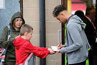 Lincoln City's Tyler Walker signs autographs for fans as he arrives at the ground<br /> <br /> Photographer Chris Vaughan/CameraSport<br /> <br /> The Carabao Cup Second Round - Lincoln City v Everton - Wednesday 28th August 2019 - Sincil Bank - Lincoln<br />  <br /> World Copyright © 2019 CameraSport. All rights reserved. 43 Linden Ave. Countesthorpe. Leicester. England. LE8 5PG - Tel: +44 (0) 116 277 4147 - admin@camerasport.com - www.camerasport.com