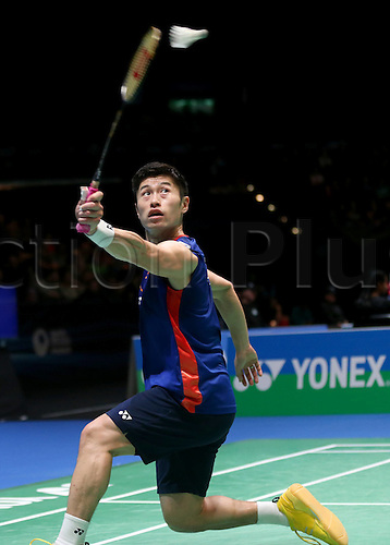 10.03.2016. Birmingham, England.  Sho Sasaki of Japan returns the shuttlecock during the mens singles second round match with China s Lin Dan at the 2016 YONEX All England Open Badminton Championships in Birmingham, Britain on March 10, 2016. Lin Dan won 2-1.