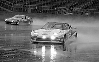 The #63 Mazda of Jim Downing, Jon Maffucci and Steve Potter enters pit road in the rain during the 1983 24 Hours of Daytona , Daytona Internationa Speedway, Daytona Beach, FL, February 1-2, 1983.  (Photo by Brian Cleary / www.bcpix.com)