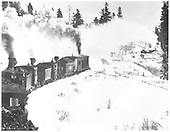 D&amp;RGW rotary snow plow OM being pushed by #216 C-16 and several other engines.<br /> D&amp;RG  Cresco, NM  Taken by Ballough, Monte - 3/1909