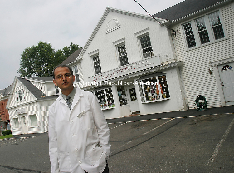 WATERTOWN, CT - 25 July 2005- 072505BZ02- Pharmacist Sanjay Patel poses in front of the Health Complex he recently purchased in Watertown.  <br /> Jamison C. Bazinet Photo