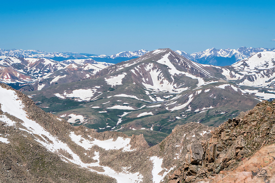 Mount Evans, Colorado features the highest paved road in North America - over 14,000 feet.  The summit provides beautiful views of the surrounding Rocky Mountains.