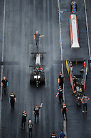Jan. 20, 2012; Jupiter, FL, USA: Aerial view of NHRA top fuel dragster driver Hillary Will as she backs up from her burnout during testing at the PRO Winter Warmup at Palm Beach International Raceway. Mandatory Credit: Mark J. Rebilas-