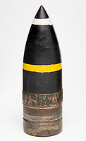 BNPS.co.uk (01202 558833)<br /> Pic: TheTankMuseum/BNPS<br /> <br /> Back on display - the worlds first tank shell.<br /> <br /> Shellshocked - Red-faced boffins rediscover the worlds first tank shell...in one of their own display cabinets !<br /> <br /> A search was instigated after a staff member unearthed a decades-old handwritten catalogue that listed the long forgotten round as part of the Tank Museum's collection.<br /> <br /> The historic projectile was eventually rediscovered in a cabinet full of shells of different calibres without its significance being noted.<br /> <br /> The 6lbs shell was fired from the prototype Mark I tank during its first trial at Burton Park in Lincolnshire on 20 January 1916, after two members of the Landships Committee had a bet that the revolutionary machine would fall apart. <br /> <br /> After a 2 hour search of the Park the fired round was retrieved for posterity before becoming lost in the museums vast collection.