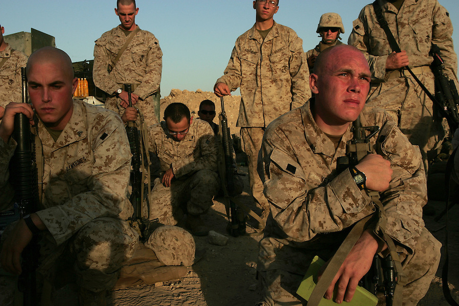 The Marines of  Kilo Co. 3rd Battalion 1st Marine Regiment (3/1) take a moment to pray and reflect before leaving their base for the commencement of Operation River Gate - a search for insurgents and weapons in the Al-Anbar Province city of Haditha, Iraq on Monday. Oct. 3, 2005. The operation which began in the pre-dawn hours met virtually no resistance as insurgents melted away into the city's populace.
