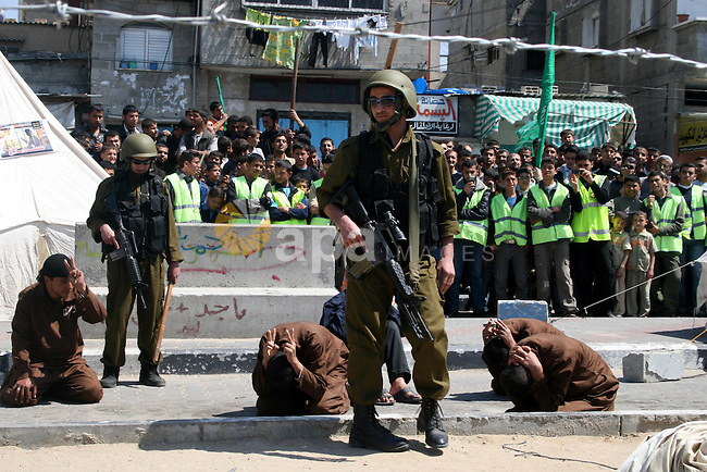 Palestinians enact a scene in which Israeli soldiers arrest Palestinians, during a protest organized by Hamas in Jabalya in the northern Gaza Strip April 17, 2009. In solidarity with Palestinian prisoners held in Israeli jails, Palestinians mark Palestinian Prisoners Day on Friday. APAIMAGES PHOTO / Ashraf Amra