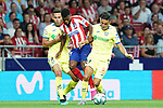 Atletico de Madrid's Thomas Lemar (c) and Getafe CF's Bruno Gonzalez (l) and Faycal Fajr during La Liga match. August 18,2019. (ALTERPHOTOS/Acero)