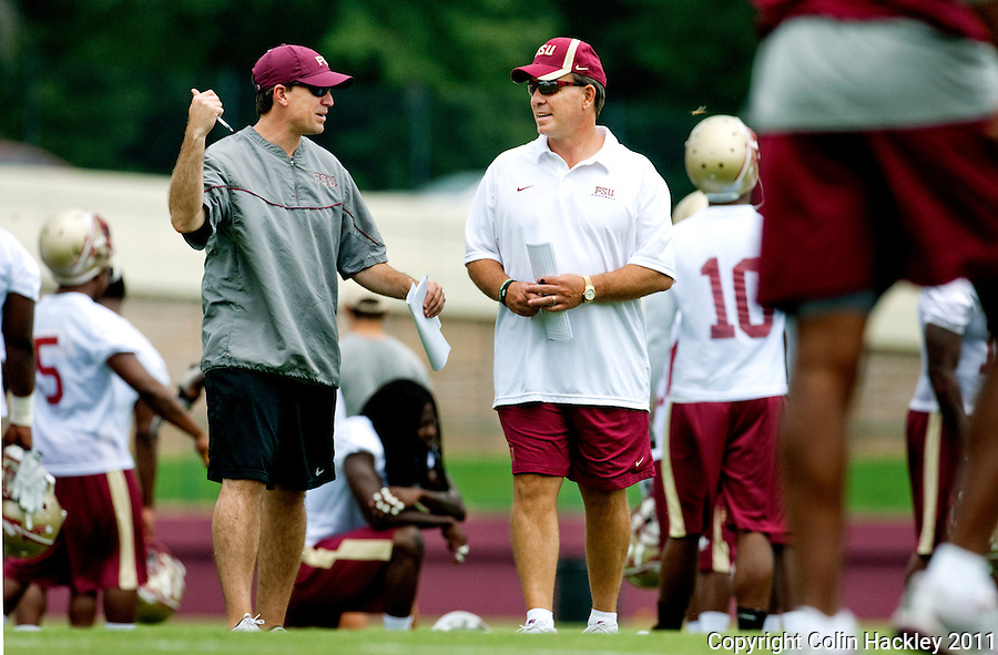 TALLAHASSEE, Fla. 8/8/11-FSU080811 CH-Florida State Offensive Coordinator James Coley, left, and Head Coach Jimbo Fisher talk during the first day of practice Monday in Tallahassee. .COLIN HACKLEY PHOTO