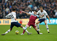 23rd November 2019; London Stadium, London, England; English Premier League Football, West Ham United versus Tottenham Hotspur; Declan Rice of West Ham United is marked by Dele Alli and Eric Dier of Tottenham Hotspur - Strictly Editorial Use Only. No use with unauthorized audio, video, data, fixture lists, club/league logos or 'live' services. Online in-match use limited to 120 images, no video emulation. No use in betting, games or single club/league/player publications