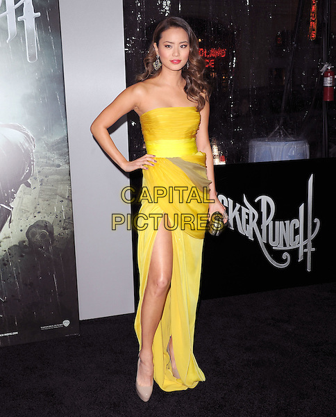 "JAMIE CHUNG .at The Warner Bros. Pictures World Premiere of ""Sucker Punch"" held at The Grauman's Chinese Theatre in Hollywood, California, USA,.March 23rd 2011..full length dress clutch bag slit split strapless yellow ruched brown thigh shoes platform beige hand on hip  .CAP/RKE/DVS.©DVS/RockinExposures/Capital Pictures."