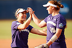 OKLAHOMA CITY, OK - JUNE 04: Taylor Van Zee #3 and Gabbie Plain #16 of the Washington Huskies high five during the Division I Women's Softball Championship held at USA Softball Hall of Fame Stadium - OGE Energy Field on June 4, 2018 in Oklahoma City, Oklahoma. (Photo by Shane Bevel/NCAA Photos via Getty Images)