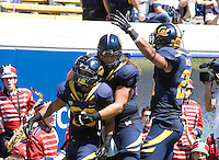 Isi Sofele of California celebrates with teammates after scoring a touchdown during the game against Southern Utah at Memorial Stadium in Berkeley, California on September 8th, 2012.   California Golden Bears defeated Southern Utah, 50-31.