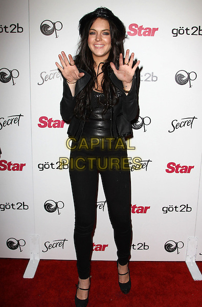 LINDSAY LOHAN.Star Magazine Celebrates Young Hollywood held at Voyeur, West Hollywood, California, USA..March 31st, 2010.full length black leather hat top hands palms jacket leggings shoes mary janes platform .CAP/ADM/KB.©Kevan Brooks/AdMedia/Capital Pictures.