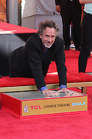 HOLLYWOOD, CA - SEPTEMBER 08: Tim Burton attends Director Tim Burton honored with a Hand and Footprint Ceremony at TCL Chinese Theatre IMAX on September 8, 2016 in Hollywood, California. (Credit: Parisa/MediaPunch LTD.)
