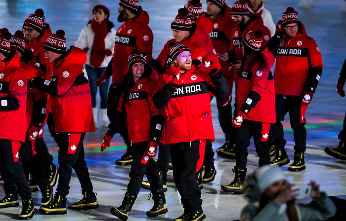 PyeongChang 9/3/2018 - Flag bearer Brian McKeever leads Team Canada into the Paralympic Stadium during the opening ceremony of the 2018 Winter Paralympic Games in Pyeongchang, Korea. Photo: Dave Holland/Canadian Paralympic Committee