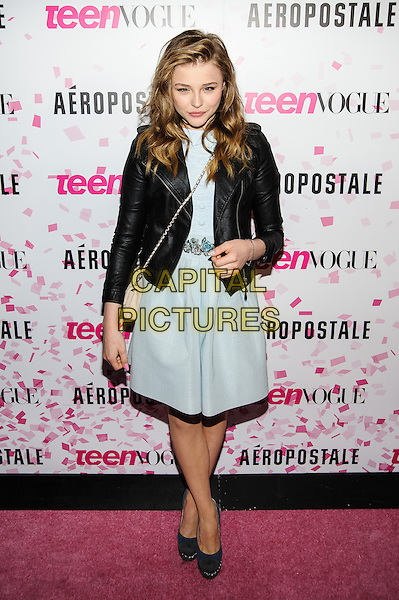 Chloe Grace Moretz.Teen Vogue 10th Anniversary And Chloe Grace Moretz Sweet 16 Celebration, New York, New York, USA, .7th February 2013..full length black leather jacket baby pale blue dress  cross strap over body bag peach chanel chain peach handbag  shoes grey gray .CAP/ADM/MS.©Mario Santoro/AdMedia/Capital Pictures.