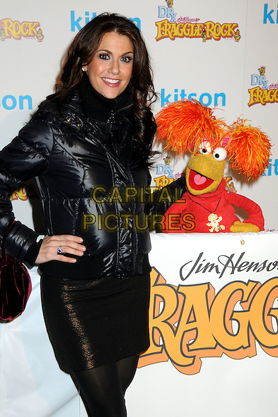 SAMANTHA HARRIS & RED FRAGGLE .The Dr. Romanelli Fraggle Rock Clothing Collaboration & The Anita Ko Fraggle Rock Costume Jewelry Collection in Partnership with Volkswagen Host A Toy Drive to benefit the L.A. Mission held at Kitson, West Hollywood, California, .9th December 2009..half length black puffa jacket puffer hand on hip puppet mini skirt .CAP/ADM/BP.©Byron Purvis/AdMedia/Capital Pictures.