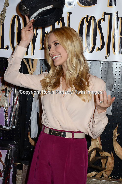 Kristin Cavallari hosts the Bing It On Halloween Costume Challenge on October 19, 2012 at Spirit Halloween Store in New York City.  She was wearing Naben Shorts and the shirt was by Olcay Galsen.