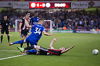 Caolan Lavery of Sheffield United goes down under a challenge from Josh Knight of Leicester City during the Carabao Cup match between Sheffield United and Leicester City at Bramall Lane, Sheffield, England on 22 August 2017. Photo by James Williamson / PRiME Media Images.