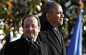 United States President Barack Obama and French President Francois Hollande deliver remarks during an official State Visit on the South Lawn of the White House February 11, 2014 in Washington, DC. The two leaders will hold bilateral meetings, a joint press conference and attend an official State Dinner later in the day.  <br /> Credit: Chip Somodevilla / Pool via CNP