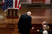 Former Sen. Alan Simpson, R-Wyo, center, speaks with former President George Bush, right, as he walks to a podium to speak during the State Funeral for former President George H.W. Bush at the National Cathedral, Wednesday, Dec. 5, 2018, in Washington. <br /> Credit: Andrew Harnik / Pool via CNP