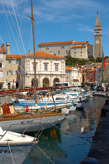 Sailing boats in harbour with Italian style buildings & church. Piran , Slovenia