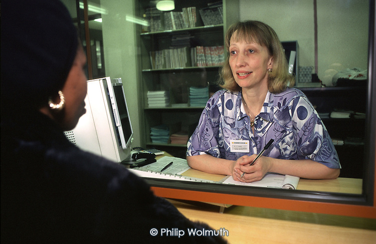 A Haringey resident receives advice at the council's Wood Green housing office, North London.