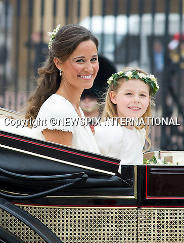 """PIPPA MIDDLETON.THE ROYAL WEDDING.The Newly married couple The Duke and Duchess of Cambridge take in the splendor of the crowds on thier way from Westminster Abbey to Buckingham Palace in the wedding Carriages..Prince William and Catherine Middleton marry at Westminster Abbey..The Duke and Duchess of Cambridge London_29/04/2011.Mandatory Photo Credit: ©Dias/Newspix International..**ALL FEES PAYABLE TO: """"NEWSPIX INTERNATIONAL""""**..PHOTO CREDIT MANDATORY!!: NEWSPIX INTERNATIONAL(Failure to credit will incur a surcharge of 100% of reproduction fees)..IMMEDIATE CONFIRMATION OF USAGE REQUIRED:.Newspix International, 31 Chinnery Hill, Bishop's Stortford, ENGLAND CM23 3PS.Tel:+441279 324672  ; Fax: +441279656877.Mobile:  0777568 1153.e-mail: info@newspixinternational.co.uk"""