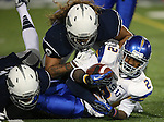 San Jose State's Tim Crawley gets tackled by Nevada defenders during the second half of an NCAA college football game in Reno, Nev., on Saturday, Nov. 16, 2013. Nevada defeated San Jose State 38-16.<br /> (AP Photo/ Cathleen Allison).