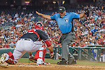 22 July 2016: MLB Umpire Dan Bellino calls safe on a play at the plate during a game between the Washington Nationals and the San Diego Padres at Nationals Park in Washington, DC. The Padres defeated the Nationals 5-3 to take the first game of their 3-game, weekend series. Mandatory Credit: Ed Wolfstein Photo *** RAW (NEF) Image File Available ***