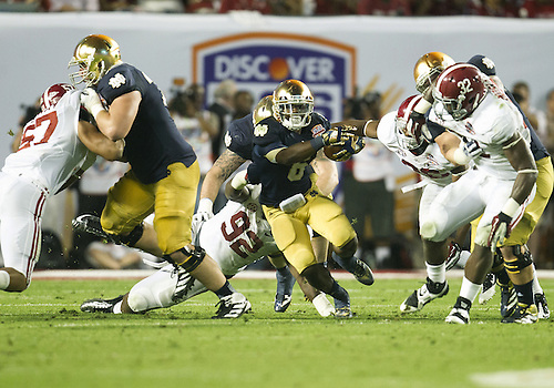 January 7, 2013:  Notre Dame running back Theo Riddick (6) runs for yardage during the Discover BCS National Championship between the Alabama Crimson Tide and the Notre Dame Fighting Irish at Sun Life Stadium in Miami Gardens, Florida.  Alabama defeated Notre Dame 42-14.