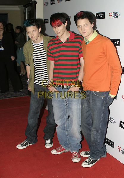 THE NOISE NEXT DOOR.Arrivals at the Cyistic Fibrosis Trust Breathing Life Awards, Royal Lancaster Hotel, .London, April 28th 2005..full length boy band red hair brothers triplets family striped t-shirts tops orange jumper dyed hair.Ref: AH.www.capitalpictures.com.sales@capitalpictures.com.©Adam Houghton/Capital Pictures.