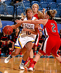 BROOKINGS, SD - OCTOBER 29:  Kerri Young #10 from South Dakota State drives the baseline between Kyli Van Klei #40 and Betsy MacDonald #2 from St. Cloud State in the first half of their exhibition game Thursday night at Frost Arena in Brookings. (Photo by Dave Eggen/Inertia)