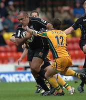 2005/06 Guinness Premiership Rugby, Saracens vs Northampton Saints, Vicarage Road, Watford, ENGLAND: Simon  Raiwalui's break through is challenges by Saints, Rhodri Davies.      05.11.2005   © Peter Spurrier/Intersport Images - email images@intersport-images..